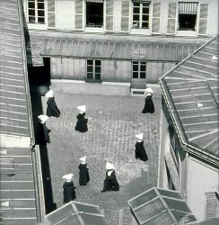 Sœurs dans la cour de St Vincent-de-Paul, Paris vers 1950 by Almasy Paul